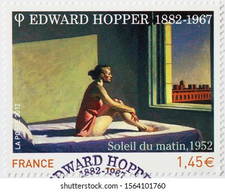 Milan, Italy - November 09, 2019: Famous painting by Edward Hopper on french postage stamp