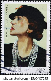 Milan, Italy - November 09, 2019: Famous stylist Gabriel Coco Chanel on postage stamp