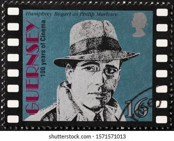 Milan, Italy - November 09, 2019: Humphrey Bogart as Philip Marlowe on postage stamp