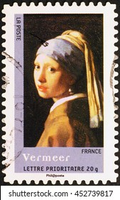 Milan, Italy - November 11, 2014: Famous painting by Vermeer on french postage stamp
