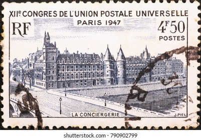 Milan, Italy - November 11, 2014: Palais de la Cite in Paris on vintage stamp