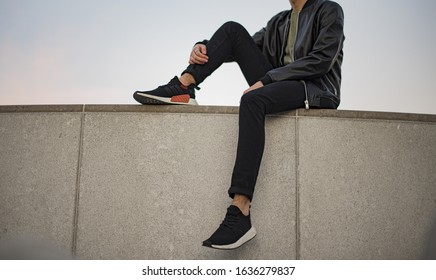 Milan, Italy - November 11, 2017: Young man wearing Adidas NMD 2 shoes in the street - illustrative editorial