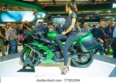 MILAN, ITALY - NOVEMBER 11, 2017: a model poses for the visitors during the EICMA 2017 - 75th International Motorcycle Exhibition.