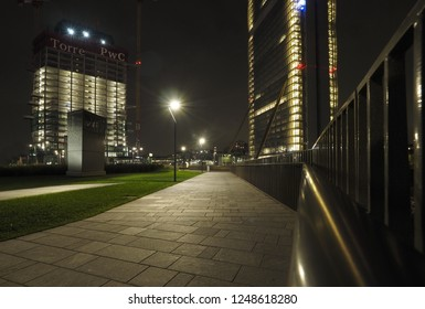 """MILAN, ITALY, November 11, 2018 - PWC Tower in """"City Life"""" complex in 3 Torri Milan place, modern buildings and condos."""