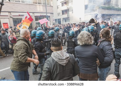 MILAN, ITALY - NOVEMBER 13: Students confront police during a march in the city streets to protest agaist the public school management on NOVEMBER 13, 2015 in Milan.