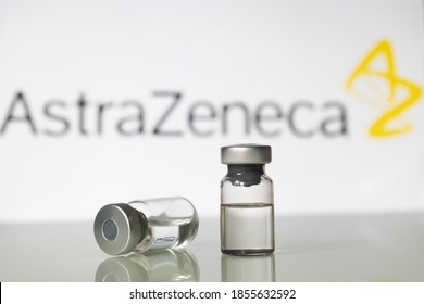 Milan, Italy: November 14, 2020: Vaccine vials with AstraZeneca Plc logo. Big Pharma companies are racing to complete clinical trials to get the approval for a vaccine to fight the coronavirus Covid-1
