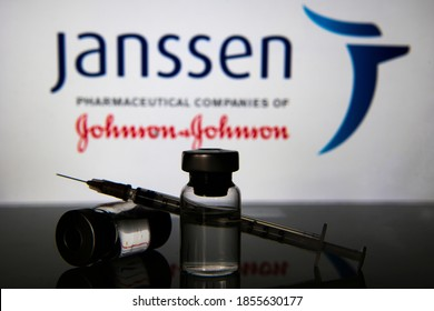 Milan, Italy: November 16, 2020: Vaccine vials and syringe with Janssen Pharmaceutical logo. Big Pharma companies are racing to complete clinical trials for a vaccine to fight the coronavirus Covid-19