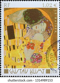 Milan, Italy – November 17, 2016: Detail of the kiss by Klimt on french stamp