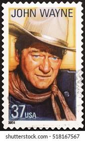 Milan, Italy - November 18, 2016: John Wayne on american postage stamp