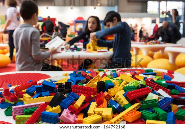 MILAN, ITALY - NOVEMBER 22: Detail of Lego building bricks at G! come giocare, trade fair dedicated to games, toys and children on NOVEMBER 22, 2013 in Milan.