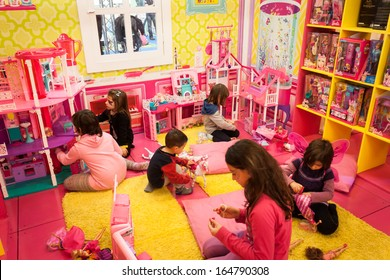 MILAN, ITALY - NOVEMBER 22: Girls play inside Barbie's house at G! come giocare, trade fair dedicated to games, toys and children on NOVEMBER 22, 2013 in Milan.