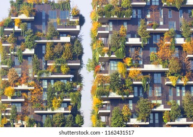 MILAN, ITALY, NOVEMBER 23, 2017 New and modern condo building with trees growing on balconies, Bosco Verticale residential towers in milan (Vertical forest) reduce global warming in concept.