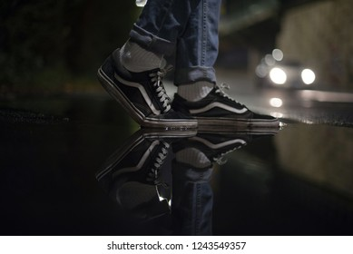 Milan, Italy - November 24, 2018: Young man wearing Vans Old Skool shoes in the street - illustrative editorial