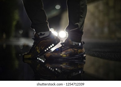 Milan, Italy - November 24, 2018: Man wearing Nike Air Max 97 Camouflage shoes in the street - illustrative editorial