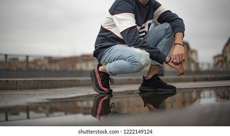 Milan, Italy - November 3, 2018: Man wearing a pair of Adidas Yeezy 350