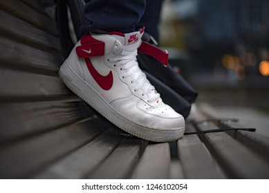 Milan, Italy - November 4, 2018: Young man wearing Nike Air Force high shoes in the street - illustrative editorial