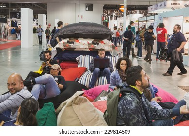 MILAN, ITALY - NOVEMBER 5: People take a rest at EICMA, international motorcycle exhibition on NOVEMBER 5, 2014 in Milan.