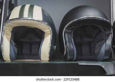 MILAN, ITALY - NOVEMBER 5: Stylish helmets on display at EICMA, international motorcycle exhibition on NOVEMBER 5, 2014 in Milan.