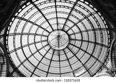 MILAN, ITALY - NOVEMBER 6: Unique view of Galleria Vittorio Emanuele II seen from above in Milan on November 6, 2012. Built in 1875 this gallery is one of the most popular shopping areas in Milan.