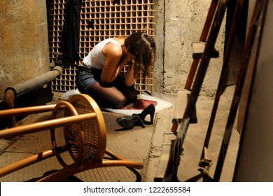 Milan - Italy november 6,2018 - sexual violence and rape - girl, woman victim of violence, despairing sitting on the ground after the abuse