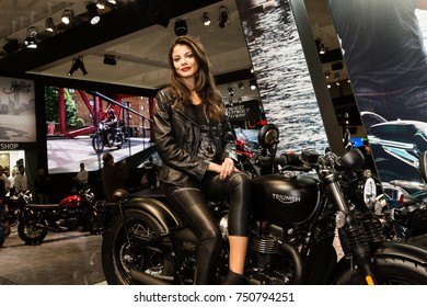 MILAN, ITALY - NOVEMBER 7: Beautiful model poses at EICMA, international motorcycle exhibition on NOVEMBER 7, 2017 in Milan.
