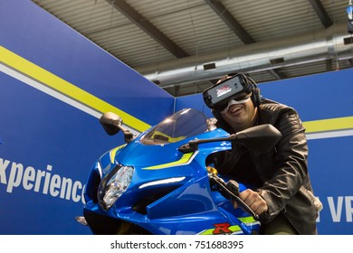 MILAN, ITALY - NOVEMBER 7: Man tries virtual reality headset at EICMA, international motorcycle exhibition on NOVEMBER 7, 2017 in Milan.