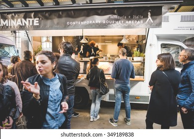 MILAN, ITALY - NOVEMBER 7: People visiting Eat Market, a street food parade with international dishes in Milan on November, 7 2015. People being served by El Caminante food truck at Eat Market
