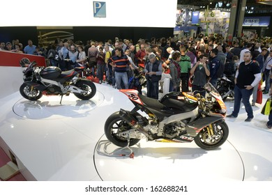 MILAN, ITALY - NOVEMBER 8: People visit Aprilia motorcycles and scooters exhibition area at EICMA, 71st International Motorcycle Exhibition on November 8, 2013 in Milan, Italy.