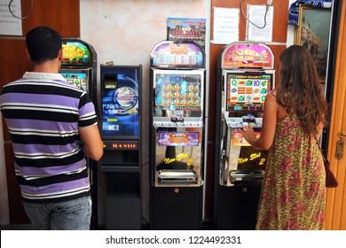 Milan , Italy november 8,2018 - slot machines, gambling machines in a bar - video poker and gambling addiction