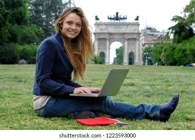 Milan, Italy Novenber 7,2018 - girl use  her laptop computer with wi-fire ( wi-fi ) internet outdoor