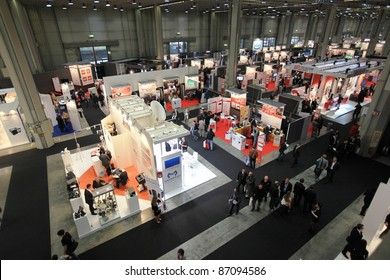 MILAN, ITALY - OCT. 19: Panoramic view of people visiting technologies stands at SMAU, international fair of business intelligence and information technology October 19, 2011 in Milan, Italy.