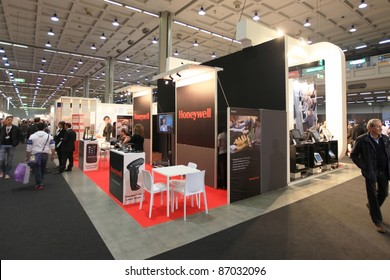 MILAN, ITALY - OCT. 19: People visit Honeywell technologies stand during SMAU, international fair of business intelligence and information technology October 19, 2011 in Milan, Italy.