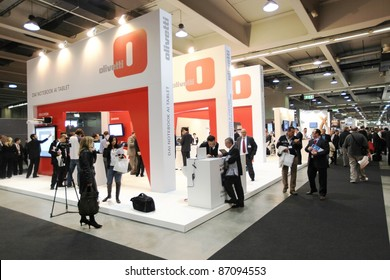 MILAN, ITALY - OCT. 19: People at Olivetti technologies area during SMAU, international fair of business intelligence and information technology October 19, 2011 in Milan, Italy.