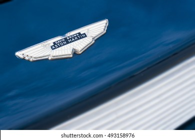 MILAN / ITALY - OCTOBER 01, 2016: Closeup of an old Aston Martin logo on a vintage car model