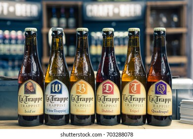 Milan, Italy - October 11, 2016: close up on trappist beer bottles, background is blurred.