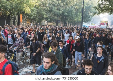 MILAN, ITALY - OCTOBER 13, 2017: Students march in the city streets to protest against the policy of the government on the school, asking  for more rights and protection for their future working life.