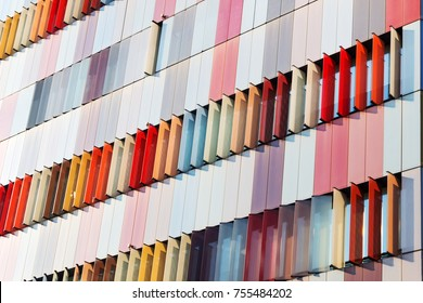 MILAN ITALY OCTOBER 13, 2017 Modern exterior of a bright & colorful office building in Milan, Italy in blue sky background, Beautiful & colorful window building.