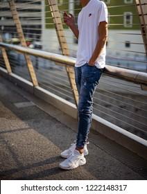 Milan, Italy - October 13, 2018: teenager wearing a pair of white Nike Huarache