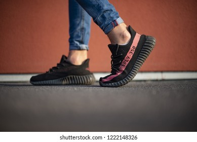 Milan, Italy - October 13, 2018: Man wearing a pair of Adidas Yeezy 350