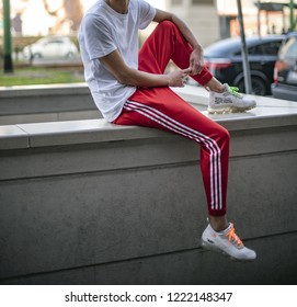 Milan, Italy - October 13, 2018: teenager wearing a pair of white Nike Vapor Max Off white