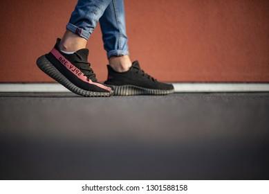 Milan, Italy - October 13, 2018: Man wearing a pair of Adidas Yeezy 350