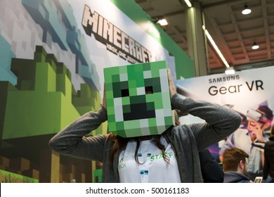 MILAN, ITALY - OCTOBER 14: People play at Games Week 2016, event dedicated to video games and electronic entertainment on OCTOBER 14, 2016 in Milan.