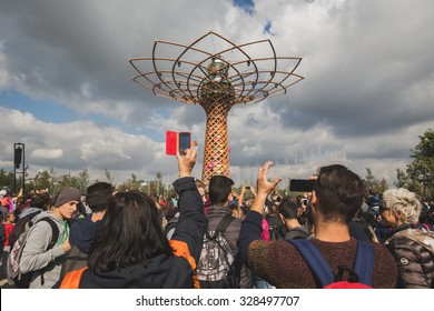 MILAN, ITALY - OCTOBER 16: People take pictures of Tree of Life at Expo, universal exposition on the theme of food on OCTOBER 16, 2015 in Milan.