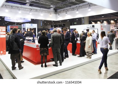 MILAN, ITALY - OCTOBER 17: People visit technology products exhibition area at SMAU, international fair of business intelligence and information technology October 17, 2012 in Milan, Italy.