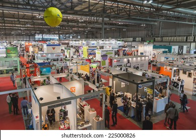 MILAN, ITALY - OCTOBER 17: Top view of people and booths at Viscom, international trade fair and conference on visual communication and event services on OCTOBER 17, 2014 in Milan.