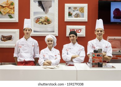 MILAN, ITALY - OCTOBER 18: Young cooks pose at Host 2013, international exhibition of the hospitality industry on OCTOBER 18, 2013 in Milan.