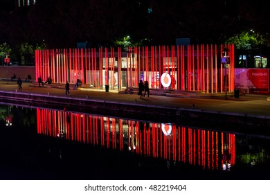 Milan, Italy - October 19th, 2015:High luminous red pillars with Vodafone logo on the waterfront in Milan.