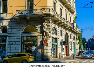 Milan, Italy - October 19th, 2015:The old pharmacy building with sculpture molding men and women on a corner street Filippo Turati in Milan, Italy.