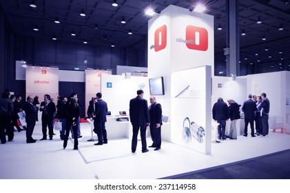 MILAN, ITALY - OCTOBER 20, 2010: People visit Olivetti products stands at SMAU, international fair of business intelligence and information technology in Milan, Italy.