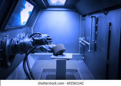 Milan, Italy - October 20, 2015:  Blasting of a mechanical piece printed with additive manufacturing